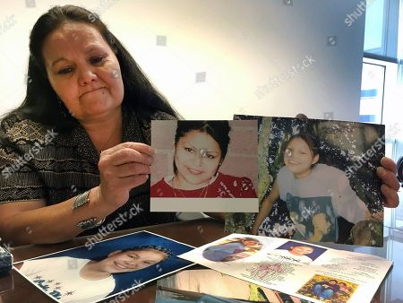 """Roberta Tortice, Katherine Kat Tortice. Roberta Tortice holds up photos of her daughter, Katherine """"Kat"""" Tortice at the federal courthouse in Phoenix on . Katherine """"Kat"""" Tortice's body was found in a shallow grave on an American Indian reservation in Arizona more than a decade ago, and now the man responsible for leaving the teenager for dead is going to prison for eight years. Andre Hinton was sentenced Tuesday by U.S. District Judge David Campbell in Phoenix, who said he enhanced the punishment """"to protect further victims that may be assaulted by Mr. Hinton"""