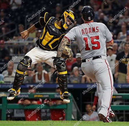 Elias Diaz, Matt Adams. Pittsburgh Pirates catcher Elias Diaz, left, comes down with a high relay throw in time to tag out Washington Nationals' Matt Adams during the seventh inning of a baseball game in Pittsburgh