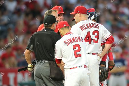 Stock Picture of Los Angeles Angels starting pitcher Garrett Richards (43) talks with a trainer and will leave the game with an apparent injury in the game between the Seattle Mariners and Los Angeles Angels of Anaheim, Angel Stadium in Anaheim, CA, Photographer: Peter Joneleit