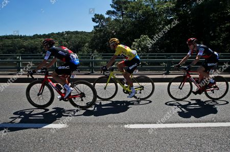 Belgium's Greg van Avermaet, wearing the overall leader's yellow jersey, rides with his teammates Italy's Damiano Caruso, left, and Tejay van Garderen of the U.S., right, during the fifth stage of the Tour de France cycling race over 204.5 kilometers (127 miles) with start in Lorient and finish in Quimper, France