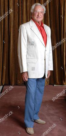 Stock Photo of Michael Winner The 70-year-old Film Director Has Shed Three-and-a-half Stone. This Week He Said Dieting Means He Can Wear His 70s Wardrobe. Femail Put Him To The Test. Picture Shows: Michael Wearing A Striped Jacket. 'i Wore This For Dinner At The Savoy With Robert Mitchum. This Jacket Is Dunhill-very Narrow Lapels-but Most Of Mine Were Handmade By Maxwell Vine Of Savile Row-he Made Al The Clothes For Big Stars Like Mitchum Laurence Harvey And Christopher Plummer So I Wanted Him To Make Them For Me Too.' A Slim-line Michael Winner Steps Back To His 70's/80's Wardrobe.