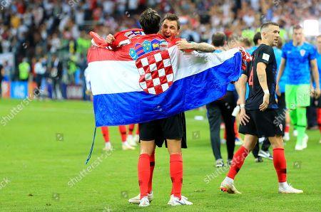 Mario Mandzukic of Croatia celebrates at the end of the game with Vedran Corluka of Croatia