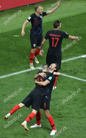 Croatia's Marcelo Brozovic, foreground left, and Vedran Corluka celebrate at the end of the semifinal match between Croatia and England at the 2018 soccer World Cup in the Luzhniki Stadium in Moscow, Russia