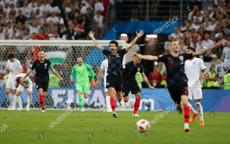 Croatia's Vedran Corluka, center, celebrates after his team advanced to the final during the semifinal match between Croatia and England at the 2018 soccer World Cup in the Luzhniki Stadium in Moscow, Russia