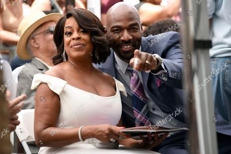 "Niecy Nash, left, best known for her roles in ""Reno 911!"" and ""Claws,"" sits in the audience with husband Jay Tucker during a ceremony honoring her with a star on the Hollywood Walk of Fame, in Los Angeles"