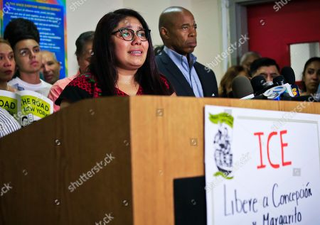 Brooklyn Borough President Eric Adams, center, stands next to Perla Silva, daughter of Concepcion and Margarito Silva, who are in an Immigration and Customs Enforcement detention center, plea for their release during a news conference, in New York. Concepcion and Margarito Silva were arrested by federal immigration officials on July 4 after they arrived at Fort Drum for a holiday visit with their daughter and their enlisted son-in-law, who live on the base