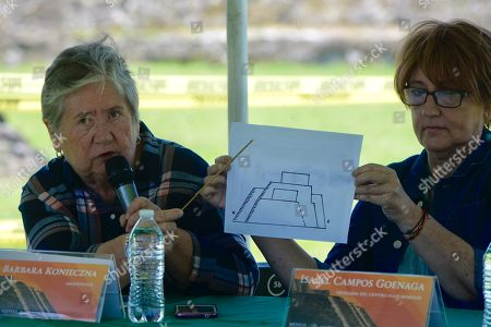 Stock Picture of The archaeologists Barbara Konieczna (L) and Isabel Campos Geonaga (R) explain details of a wall discovered in the substructure, with the same architectural characteristics of the upper temple, at the archaeological site of Teopanzolco, Morelos state, Mexico, 11 July 2018. An earthquake on 19 September 2017 caused serious damage to the Teopanzolco archaeological zone in central Mexico, but also brought about a revelation: a new building of worship that could be older than the Templo Mayor (Greater Temple) of the Aztec city of Tenochtitlan. The site remains protected and closed to the public since the 7.1-magnitude quake put its stability at risk.