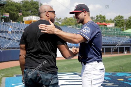 Tim Tebow, right, talks to former New York Yankees player Bernie Williams prior to the Eastern League All-Star minor league baseball game, in Trenton, N.J