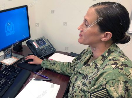 Megan Stevenson. U.S. Navy Legalman First Class Tamatha Schulmerich works at her desk at the Naval War College, in Newport, R.I. The Navy said Tuesday it will let women sailors sport ponytails and other longer hairstyles, reversing a policy that long forbade females from letting their hair down