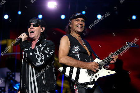 Vocalist Klaus Meine (L) and guitarist Matthias Jabs of the German rock band Scorpions perform during a concert at Mario Wilson Stadium, Oeiras, Portugal, 11 July 2018.