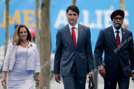 (L-R) Canada's Foreign Minister Chrystia Freeland, Canadian Prime Minister Justin Trudeau and Canadian Defense Minister Harjit Sajjan arrive for the second day of a NATO summit in Brussels, Belgium, 12 July 2018. NATO countries' heads of states and governments gather in Brussels for a two-day meeting.