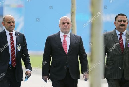 Iraqi Prime Minister Haider al-Abadi (C) arrives for the second day of a NATO summit in Brussels, Belgium, 12 July 2018. NATO countries' heads of states and governments gather in Brussels for a two-day meeting.