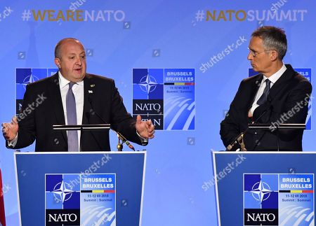 Georgian President Giorgi Margvelashvili, left, and NATO Secretary-General Jens Stoltenberg speak at a press conference during a summit of heads of state and government at NATO headquarters in Brussels, Belgium, . NATO leaders gather in Brussels for a two-day summit