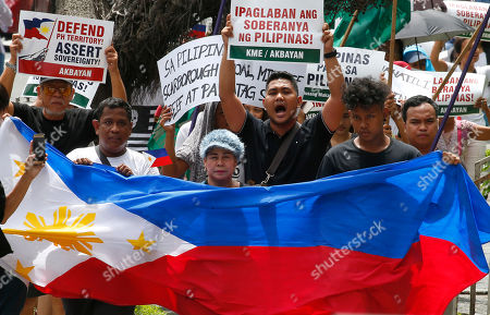 Protesters shout slogans while marching with a Philippine flag towards the Chinese Consulate to mark the second anniversary of the United Nations Permanent Court of Arbitration's decision upholding the Philippines' territorial rights in the disputed Spratlys Group of islands in the South China Sea, in Manila, Philippines. The ruling was shelved by President Rodrigo Duterte and was never recognized by China and continues instead to build military facilities on the disputed islands