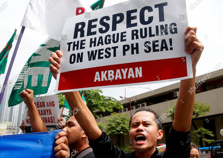 Protesters shout slogans during a rally at the Chinese Consulate to mark the second anniversary of the United Nations Permanent Court of Arbitration's decision upholding the Philippines' territorial rights in the disputed Spratlys Group of islands in the South China Sea, in Manila, Philippines. The ruling was shelved by President Rodrigo Duterte and was never recognized by China and continues instead to build military facilities on the disputed islands