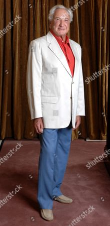 Michael Winner The 70-year-old Film Director Has Shed Three-and-a-half Stone. This Week He Said Dieting Means He Can Wear His 70s Wardrobe. Femail Put Him To The Test. Picture Shows: Michael Wearing A Striped Jacket. 'i Wore This For Dinner At The Savoy With Robert Mitchum. This Jacket Is Dunhill-very Narrow Lapels-but Most Of Mine Were Handmade By Maxwell Vine Of Savile Row-he Made Al The Clothes For Big Stars Like Mitchum Laurence Harvey And Christopher Plummer So I Wanted Him To Make Them For Me Too.' A Slim-line Michael Winner Steps Back To His 70's/80's Wardrobe.