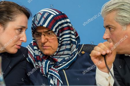 Stock Image of (L-R) Lawyer Seda Basay, Adile Simsek, widow of NSU victim Enver Simsek and lawyer Mehmet Daimagueler attend a press conference in Berlin, Germany, 12 July 2018. The conference was on the assessments of a verdict in the NSU Trial. The court on 11 July found Beate Zschaepe, one of co-defendant in the NSU trial, guilty on ten counts of murder, some five years after the trial started. The court sentenced her to life imprisonment and established the particular severity of guilt. Zschaepe was accused of being a founding member of the extreme right-wing National Socialist Underground (NSU) terror cell and faced charges of complicity in the murder of nine Turkish and Greek immigrants and a policewoman between 2000 and 2007, as well as two bombings in immigrant areas of Cologne, and 15 bank robberies.