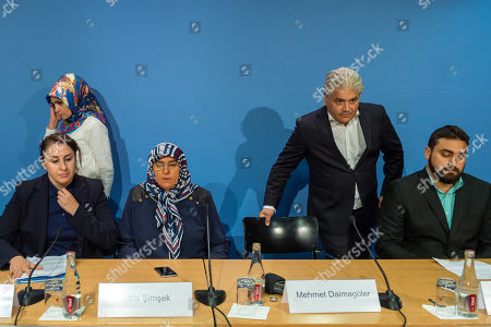 (L-R) Lawyer Seda Basay, chairman of IG Keupstrasse Meral Sahin, Adile Simsek, widow of NUS victim Enver Simsek, lawyer Mehmet Daimagueler and Abdul Kerim Simsek, son of Simsek attend a press conference in Berlin, Germany, 12 July 2018. The conference was on the assessments of a verdict in the NSU Trial. The court on 11 July found Beate Zschaepe, one of co-defendant in the NSU trial, guilty on ten counts of murder, some five years after the trial started. The court sentenced her to life imprisonment and established the particular severity of guilt. Zschaepe was accused of being a founding member of the extreme right-wing National Socialist Underground (NSU) terror cell and faced charges of complicity in the murder of nine Turkish and Greek immigrants and a policewoman between 2000 and 2007, as well as two bombings in immigrant areas of Cologne, and 15 bank robberies.