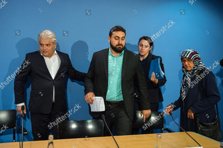 (L-R) Lawyer Mehmet Daimagueler, Abdul Kerim Simsek, son of NSU victim Enver Simsek and widow Adile Simsek and lawyer Seda Basay attend a press conference in Berlin, Germany, 12 July 2018. The conference was on the assessments of a verdict in the NSU Trial. The court on 11 July found Beate Zschaepe, one of co-defendant in the NSU trial, guilty on ten counts of murder, some five years after the trial started. The court sentenced her to life imprisonment and established the particular severity of guilt. Zschaepe was accused of being a founding member of the extreme right-wing National Socialist Underground (NSU) terror cell and faced charges of complicity in the murder of nine Turkish and Greek immigrants and a policewoman between 2000 and 2007, as well as two bombings in immigrant areas of Cologne, and 15 bank robberies.