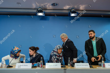 Stock Photo of (L-R) Chairman of IG Keupstrasse Meral Sahin, lawyer Seda Basay, widow of NSU victim Enver Simsek Adile Simsek, lawyer Mehmet Daimagueler and Abdul Kerim Simsek, son of Simsek attend a press conference in Berlin, Germany, 12 July 2018. The conference was on the assessments of a verdict in the NSU Trial. The court on 11 July found Beate Zschaepe, one of co-defendant in the NSU trial, guilty on ten counts of murder, some five years after the trial started. The court sentenced her to life imprisonment and established the particular severity of guilt. Zschaepe was accused of being a founding member of the extreme right-wing National Socialist Underground (NSU) terror cell and faced charges of complicity in the murder of nine Turkish and Greek immigrants and a policewoman between 2000 and 2007, as well as two bombings in immigrant areas of Cologne, and 15 bank robberies.