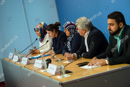 Stock Picture of (L-R) Chairman of IG Keupstrasse Meral Sahin, lawyer Seda Basay, widow of NSU victim Enver Simsek Adile Simsek, lawyer Mehmet Daimagueler and Abdul Kerim Simsek, son of Simsek attend a press conference in Berlin, Germany, 12 July 2018. The conference was on the assessments of a verdict in the NSU Trial. The court on 11 July found Beate Zschaepe, one of co-defendant in the NSU trial, guilty on ten counts of murder, some five years after the trial started. The court sentenced her to life imprisonment and established the particular severity of guilt. Zschaepe was accused of being a founding member of the extreme right-wing National Socialist Underground (NSU) terror cell and faced charges of complicity in the murder of nine Turkish and Greek immigrants and a policewoman between 2000 and 2007, as well as two bombings in immigrant areas of Cologne, and 15 bank robberies.