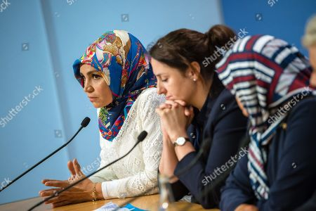 (L-R) Cchairman of IG Keupstrasse Meral Sahin, lawyer Seda Basay and Adile Simsek, widow of NSU victim Enver Simsek attend a press conference in Berlin, Germany, 12 July 2018. The conference was on the assessments of a verdict in the NSU Trial. The court on 11 July found Beate Zschaepe, one of co-defendant in the NSU trial, guilty on ten counts of murder, some five years after the trial started. The court sentenced her to life imprisonment and established the particular severity of guilt. Zschaepe was accused of being a founding member of the extreme right-wing National Socialist Underground (NSU) terror cell and faced charges of complicity in the murder of nine Turkish and Greek immigrants and a policewoman between 2000 and 2007, as well as two bombings in immigrant areas of Cologne, and 15 bank robberies.