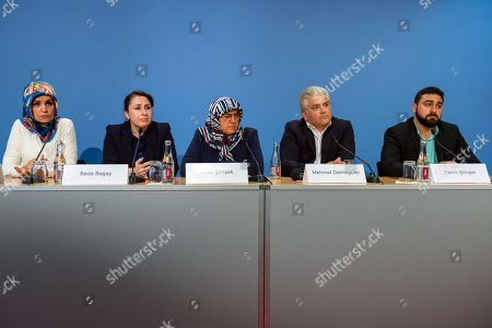 (L-R) Chairman of IG Keupstrasse Meral Sahin, lawyer Seda Basay, widow of NSU victim Enver Simsek Adile Simsek, lawyer Mehmet Daimagueler and Abdul Kerim Simsek, son of Simsek attend a press conference in Berlin, Germany, 12 July 2018. The conference was on the assessments of a verdict in the NSU Trial. The court on 11 July found Beate Zschaepe, one of co-defendant in the NSU trial, guilty on ten counts of murder, some five years after the trial started. The court sentenced her to life imprisonment and established the particular severity of guilt. Zschaepe was accused of being a founding member of the extreme right-wing National Socialist Underground (NSU) terror cell and faced charges of complicity in the murder of nine Turkish and Greek immigrants and a policewoman between 2000 and 2007, as well as two bombings in immigrant areas of Cologne, and 15 bank robberies.