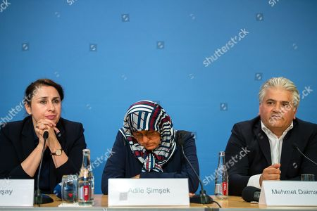 (L-R) Lawyer Seda Basay, Adile Simsek, widow of NSU victim Enver Simsek and lawyer Mehmet Daimagueler attend a press conference in Berlin, Germany, 12 July 2018. The conference was on the assessments of a verdict in the NSU Trial. The court on 11 July found Beate Zschaepe, one of co-defendant in the NSU trial, guilty on ten counts of murder, some five years after the trial started. The court sentenced her to life imprisonment and established the particular severity of guilt. Zschaepe was accused of being a founding member of the extreme right-wing National Socialist Underground (NSU) terror cell and faced charges of complicity in the murder of nine Turkish and Greek immigrants and a policewoman between 2000 and 2007, as well as two bombings in immigrant areas of Cologne, and 15 bank robberies.