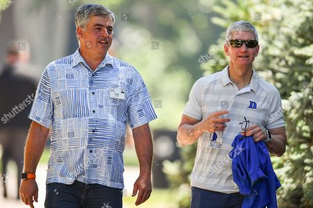 Eddy Cue and Tim Cook