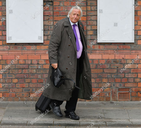 Stock Photo of Barrister Michael Mansfield Leaves After The Cps Announcement Over The Hillsborough Disaster At Parr Hall Warrington Cheshire.