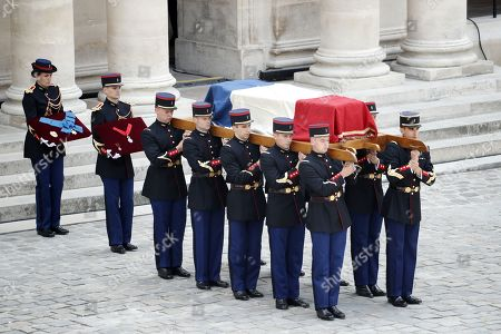Stock Photo of National guards carry the coffin of late French filmmaker Claude Lanzmann during a funeral ceremony at the Hotel des Invalides in Paris, France, 12 July 2018. Lanzmann died on 05 July 2018. He was 92.