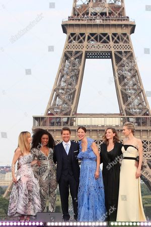 Tom Cruise, Alix Benezech, Angela Bassett, Vanessa Kirby, Michelle Monaghan, Rebecca Ferguson. Actors Alix Benezech, from left, Angela Bassett, Tom Cruise, Michelle Monaghan, Rebecca Ferguson and Vanessa Kirby pose for photographers upon arrival at the World premiere of the film 'Mission Impossible: Fallout', in Paris