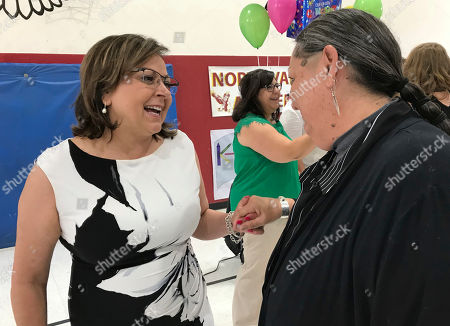Gov. Susana Martinez, left, talks with Teri Frazier, the chair of the Indian Education Advisory Council, after state education officials announced rising test scores during during an event at North Valley Academy in Los Ranchos, N.M., on . Martinez said Native American students are leading growth in achievement, having improved more than 8 percentage points in reading since 2015