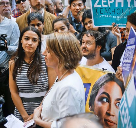 Zephyr Teachout, Alexandria Ocasio-Cortez. Alexandria Ocasio-Cortez, left, the surprise winner in the congressional race who unseated 20-year incumbent Joe Crowley in New York's Congressional District 14, listens to Zephyr Teachout, center, during a press conference, after endorsing her candidacy for Attorney General, in New York