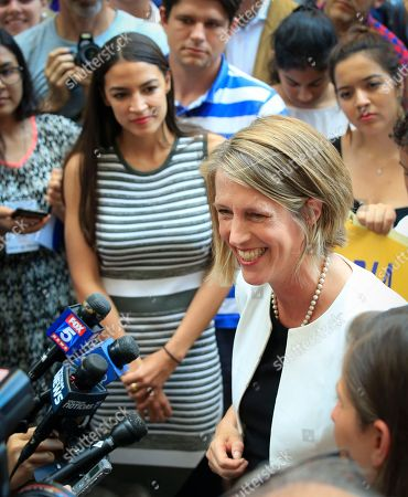Zephyr Teachout, Alexandria Ocasio-Cortez. Alexandria Ocasio-Cortez, center, the surprise winner in the congressional race who unseated 20-year incumbent Joe Crowley in New York's Congressional District 14, listens to Zephyr Teachout, right, during a press conference, after endorsing her candidacy for Attorney General, in New York