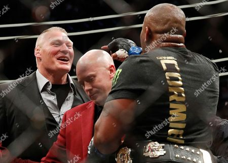 Brock Lesnar, left, taunts Daniel Cormier, after Cormier's heavyweight title mixed martial arts bout at against Stipe Miocic at UFC 226, in Las Vegas