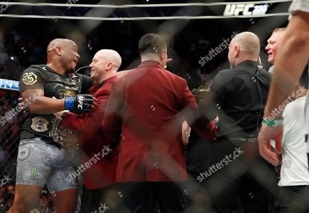 Brock Lesnar, right, taunts Daniel Cormier, left, after Cormier's heavyweight title mixed martial arts bout at against Stipe Miocic at UFC 226, in Las Vegas
