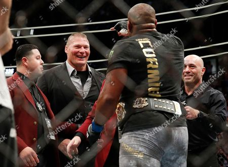 Brock Lesnar, second from left, taunts Daniel Cormier, second from right, after Cormier's heavyweight title mixed martial arts bout at against Stipe Miocic at UFC 226, in Las Vegas