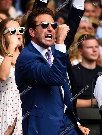 Stock Photo of Former tennis player Justin Gimelstob, who is working with John Isner, celebrates in John Isner's players box
