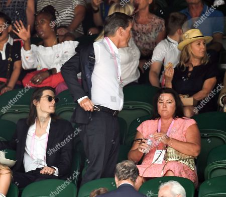 Dylan Brosnan, Pierce Brosnan and wife Keely Shaye Smith on Centre Court