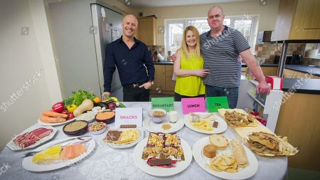 Stock Photo of (l-r) Chef and Nutritionist Dale Pinnock with the Bassetts Mum Fiona and Dad Dan on the table on the right is the food that Fiona and Dan were consuming BEFORE Dale came in and changed their diet on an average day...on the left healthy food diet Dale recommends