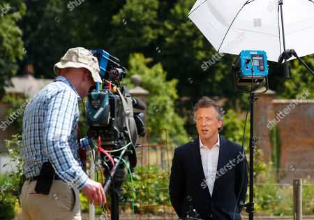 Stock Photo of Tom Newton Dunn, Political Editor of the Sun Newspaper, right, is seen speaking to Fox Television News network at Chequers, in Buckinghamshire, England, . In an interview with Sun newspaper, President Donald Trump slammed British Prime Minister Theresa May's plan for British departure from the Europe Union and praised her political rival Boris Johnson, who quit May's Cabinet this week over Brexit differences