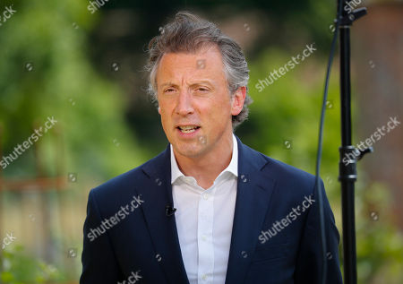 Stock Picture of Tom Newton Dunn, Political Editor of the Sun Newspaper, is seen speaking to Fox Television News network at Chequers, in Buckinghamshire, England, . In an interview with Sun newspaper, President Donald Trump slammed British Prime Minister Theresa May's plan for British departure from the Europe Union and praised her political rival Boris Johnson, who quit May's Cabinet this week over Brexit differences