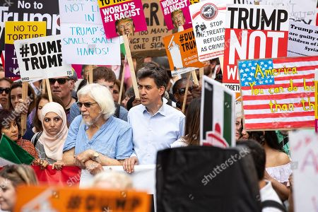 Former Labour Party leader Ed Miliband amongst demonstrators. Demonstrators march from Portland Place to Trafalgar Square in protest against US President Donald Trump's UK visit.