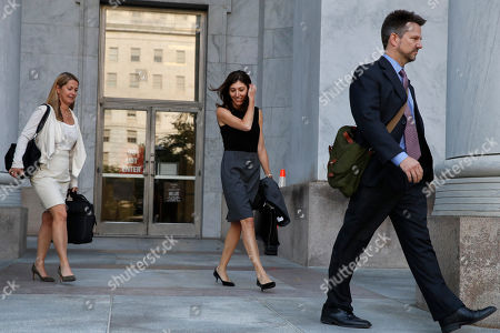 Former FBI lawyer Lisa Page, center, leaves a closed door interview with the House Judiciary and House Oversight and Government Reform committees, on Capitol Hill in Washington