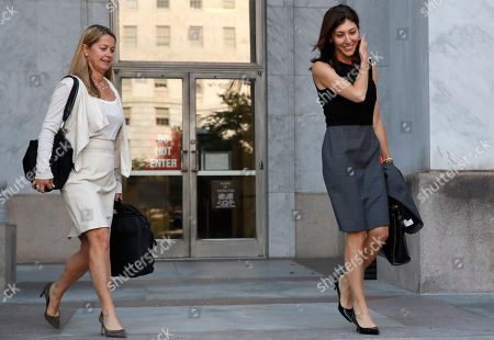 Former FBI lawyer Lisa Page, right, leaves the Rayburn House Office Building after a closed doors interview with the House Judiciary and House Oversight and Government Reform committees, on Capitol Hill in Washington