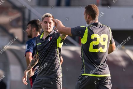 Sion's Pajtim Kasami, right, congratulates teammate Oliveira Tavares Adryan after Adryan's goal to 1:0 during a friendly soccer match FC Sion against Olympique Lyonnais at the Stade St. Germain in Saviese, canton of Valais, Switzerland, Friday, July 13, 2018.