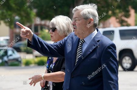 U.S. Ambassador to China and former Iowa Gov. Terry Branstad arrives at the First Christian Church with his wife Chris, rear, for funeral services for former Iowa Gov. Bob Ray, in Des Moines, Iowa. The five-term former governor died Sunday at age 89