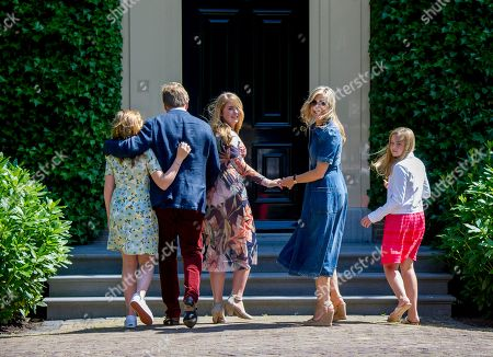 King Willem-Alexander, Queen Maxima, Princess Catharina-Amalia, Princess Alexia and Princess Ariane during the annual royal photo session in the garden of Villa Eikenhorst.
