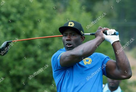 Former NFL football player Terrell Davis watches his drive from the third tee during the first round of the American Century Championship golf tournament at the Edgewood Tahoe Golf Course in Stateline, Nev